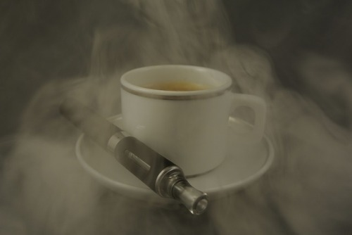cup of coffee with e-cigarette
